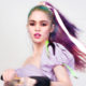 Grimes makes six million dollars for selling digital artworks as NFTs in an auction