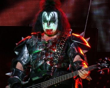 KISS Bassist Gene Simmons Recalls His First Meeting With AC/DC's Angus Young